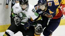 The London Knights' Patrick Kane, left, battles with Zack Torquato of the Erie Otters in 2007. Despite being from Buffalo, Kane opted to play in the OHL because he saw it as his best personal fit. Now a two-time Stanley Cup winner with the Chicago Blackhawks, Kane says the only thing he regrets about his junior hockey experience is it didn't last longer (DAVE CHIDLEY/Canadian Press)
