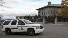 "An RCMP vehicle sits outside the Embassy of France, in Ottawa, on Saturday, Nov. 14, 2015. The federal government is forbidding the construction of new embassies on Ottawa's Sussex Drive following a stark RCMP assessment of the potential for ""violent events"" in the high-profile neighbourhood. (Justin Tang/THE CANADIAN PRESS)"