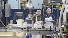Melissa Stewart (left) and Trisha Calliauw inspect jars of Nuts to You tahini. (JEREMY KOHM for Report on Business magazine)