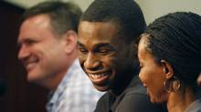 Kansas freshman NCAA college basketball player Andrew Wiggins, centre, smiles with his mother Marita Payne-Wiggins, right, during of a news conference at the University of Kansas in Lawrence, Kan., Monday, March 31, 2014. Coach Bill Self, left, smiles with the standout guard. (Associated Press)