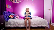 Nine-year-old Rose is seen in her bedroom at her parents home in Hamilton, Ontario. (Kevin Van Pasaen for The Globe and Mail)