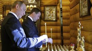 Russia's President Dmitry Medvedev and Prime Minister Vladimir Putin light candles in memory of victims of the crashed Polish government Tupolev Tu-154 aircraft at a chapel at the presidential residence Gorki outside Moscow April 10, 2010. Poland's President Lech Kaczynski, its central bank head and the country's military chief were among 96 people killed when their plane crashed in thick fog on its approach to a Russian airport on Saturday.