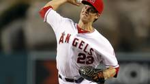 Los Angeles Angels starting pitcher Zack Greinke delivers a pitch against the Texas Rangers during the first inning of their baseball game in Anaheim, California September 20, 2012. (ALEX GALLARDO/REUTERS)