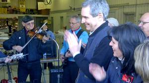 Micheal Ignatieff claps hands in times with the fiddlers at a campaign barbeque in St. Isidore, Ont., on April 14, 2011.