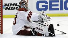 Phoenix Coyotes goalie Ilya Bryzgalov (30) of Russia throws back the puck after giving up the third goal during the first period in Game 2 of a first-round NHL Stanley Cup playoffs hockey series against the Detroit Red Wings in Detroit, Saturday, April 16, 2011. (AP Photo/Carlos Osorio) (Carlos Osorio/AP)