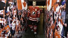 Team Canada's assistant captain Brandon Gormley walks to the ice at the Canadian national junior hockey team practice in Edmonton, Sunday Dec. 25, 2011. (JASON FRANSON/The Canadian Press)