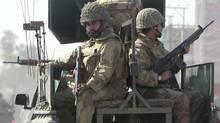 Pakistan military troops patrol on the streets of Takht Bai, about 150 km northwest of Pakistan's capital Islamabad, on May 9, 2009. (FAISAL MAHMOOD)