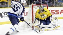 Winnipeg Jets center Mark Scheifele (55) shoots against Nashville Predators goalie Pekka Rinne (35), of Finland, in the first period of an NHL hockey game Tuesday, Jan. 5, 2016, in Nashville, Tenn. (Mark Humphrey/AP)