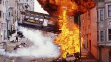 """An explosion and a flying cable car in downtown San Francisco are shown in a scene from the 1996 action drama """"The Rock."""" (REUTERS)"""