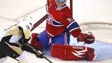 Montreal Canadiens goalie Carey Price makes a save on Pittsburgh Penguins' Ryan Bayda during the first period of NHL preseason hockey play in Montreal September 21, 2009. (SHAUN BEST)