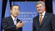 Canada's Prime Minister Stephen Harper meets with UN Secretary-General Ban Ki-moon during a bilateral meeting at the Commonwealth Heads of Government Meeting in Port-of-Spain on Nov. 28, 2009. (CHRIS WATTIE/REUTERS)