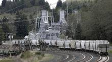 Rail cars are shown at a coal-burning TransAlta plant, near Centralia, Wash, in this file photo. (Ted S. Warren/The Associated Press)