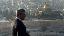 Prime Minister Stephen Harper visits Mount of Olives in Jerusalem, Israel, on Sunday, January 19, 2014. Dome of the Rock in the Old City of Jerusalem is seen in the background. (SEAN KILPATRICK/THE CANADIAN PRESS)