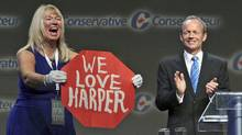 Valerie Day offers her twist on a Senate page's 'Stop Harper' protest during a speech by her husband, former Treasury Board president Stockwell Day, to the Conservative Party policy convention in Ottawa on June 9, 2011. (PATRICK DOYLE/REUTERS)