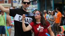 Olympians Patrick Biggs and Katie Weatherston having fun at the annual Capital Pride Parade in Ottawa. (Greg Kolz/Canadian Olympic Committee)