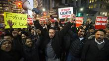 Taxi drivers protest against Uber during a demonstration at Bay and Queen in Toronto, Wednesday December 9, 2015. (Mark Blinch For The Globe and Mail)