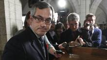 Industry Minister Tony Clement leaves after delivering a statement in the foyer of the House of Commons on Parliament Hill in Ottawa November 3, 2010. (CHRIS WATTIE/CHRIS WATTIE/REUTERS)