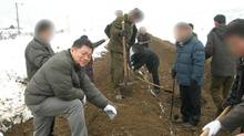 A photograph released by the Light Presbyterian Church shows Rev. Hyeon Soo Lim, who has not been seen since January, engaged in humanitarian work in North Korea in 2007. The identities of other individuals seen here were concealed by the church. Several people approached by the Globe and Mail in regard to Rev. Lim's detention in North Korea spoke of the highly sensitive nature of the case. (Handout)