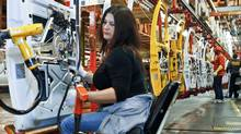 A view of employees working at the General Motors assembly plant in Wentzville, Missouri in this February 7, 2012 file photo. (SARAH CONARD/REUTERS)