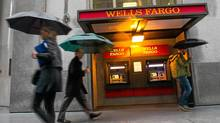 Pedestrians walk in front of Wells Fargo & Co. headquarters in San Francisco on March 14, 2012. Wells Fargo & Co. joined U.S. banks raising dividends and authorizing share repurchases after passing the Federal Reserve's test of how lenders would fare in an economic decline. (David Paul Morris/Bloomberg)