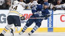 Nazem Kadri of the Toronto Maple Leafs tries to get around Robyn Regehr #24 of the Buffalo Sabres during NHL action at The Air Canada Centre December 22, 2011 in Toronto, Ontario, Canada. (Abelimages/Getty Images)