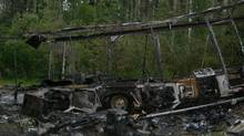 A photo released by the RCMP shows the burned out motor home of the McCanns.