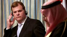 Canadian Foreign Minister John Baird, left, listens during a press conference with his Bahraini counterpart Sheik Khalid bin Ahmed Al Khalifa, right, in Manama, Bahrain, on Wednesday, April 3, 2013. (HASAN JAMALI/ASSOCIATED PRESS)