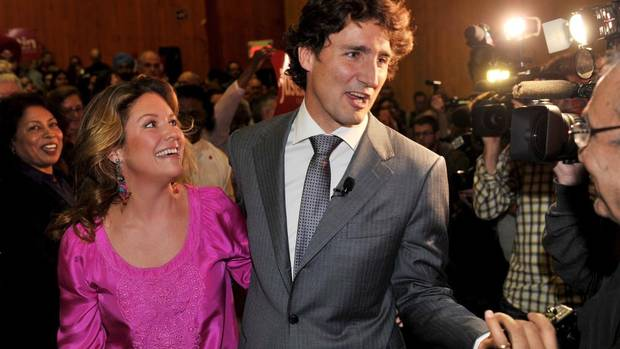 Liberal MP Justin Trudeau, and his wife, Sophie Grégoire, arrive at a news conference in Montreal. on Tuesday. (Paul Chiasson/THE CANADIAN PRESS)