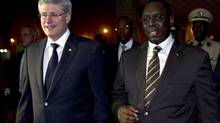 Prime Minister Stephen Harper is met by Senegal President Macky Sall as he arrive in Dakar Wednesday, October 10, 2012. (Paul Chiasson/THE CANADIAN PRESS)