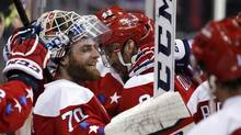 Washington Capitals goalie Braden Holtby smiles with his teammates after an NHL hockey game against the Carolina Hurricanes on March 15, 2016, in Washington. (Alex Brandon/THE ASSOCIATED PRESS)