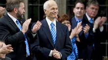 NDP Leader Jack Layton is applauded by MPs wearing blue ties and scarves in honour of his fight against prostate cancer during Question Period in the House of Commons on March 31, 2010. (Sean Kilpatrick)