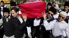 Men carry the casket of Mehdi Ali Qamar, the Canadian-American cardiologist who was assassinated in Pakistan, at his funeral service in Vaughan, Ont., on June 4, 2014. (NATHAN DENETTE/THE CANADIAN PRESS)