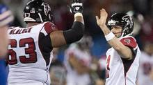 Atlanta Falcons kicker Matt Bryant (right) is congratulated by teammate Justin Blalock (63) after kicking the game winning field goal during overtime NFL action against the Buffalo Bills in Toronto on Sunday December 1, 2013. (FRANK GUNN/THE CANADIAN PRESS)