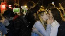 Revelers kiss as they celebrate early election returns favoring gay marriage in Washington state Referendum 74, during a large impromptu street gathering in Seattle's Capitol Hill neighborhood. (Ted S. Warren/AP)
