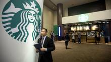 By retaining net profit to reinvest in the business, Starbucks is working for its investor. (Nelson Ching/Bloomberg)