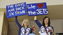 Winnipeg Jets fans cheer as their team plays the Montreal Canadiens during the first period of their NHL hockey game in Winnipeg, Oct. 9, 2011. (FRED GREENSLADE/FRED GREENSLADE / REUTERS)