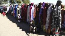 Women who have fled violence in Nigeria queue for food at a refugee welcoming center in Ngouboua, Chad, January 19, 2015. (STRINGER/REUTERS)