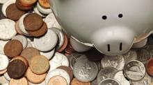 Piggy bank with Canadian coins. (Jason Verschoor/iStockphoto)