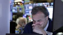 Trader Gerard Farco works on the floor of the New York Stock Exchange. (Richard Drew/AP)
