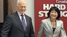 NDP Leader Jack Layton and his wife Olivia Chow walk out of Sun News Network studios after an interview on April 21, 2011 in Toronto. (Jacques Boissinot/THE CANADIAN PRESS)