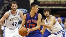 New York Knicks guard Jeremy Lin (17) passes to a teammate in front of Minnesota Timberwolves forward Kevin Love (42) and Timberwolves guard Ricky Rubio (9) during the second half of their NBA basketball game in the Target Center in Minneapolis, February 11, 2012. (ERIC MILLER/REUTERS/ERIC MILLER/REUTERS)