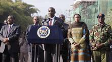 Kenyan Interior Minister Joseph ole Lenku, flanked other government officials, speaks during a news conference near the Westgate shopping mall in Nairobi on Sept. 25, 2013. (SIEGFRIED MODOLA/REUTERS)