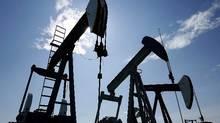 Pumpjacks at work pumping crude oil near Halkirk, Alta., June 20, 2007. THE CANADIAN PRESS/Larry MacDougal (Larry MacDougal/THE CANADIAN PRESS)