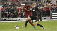 D.C. United midfielder Rob Vincent (26) battles for a ball with Toronto FC midfielder Amando Cooper (31) during the first half in a game at BMO Field on Saturday, Oct. 1, 2016. (Nick Turchiaro/USA Today Sports)