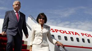 A file photo taken on July 2, 2009 shows Polish President Lech Kaczynski (L) and first lady Maria Kaczynska arriving in Baku. The couple and much of the country's military and state elite crashed in thick fog in Russia on April 10, 2010 killing all 96 people on board.