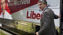Liberal Leader Stephen McNeil heads from his tour bus during a campaign stop in Halifax on Sept. 17, 2013. (ANDREW VAUGHAN/THE CANADIAN PRESS)