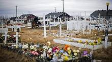 An indigenous cemetery is shown in the northern Ontario First Nations reserve in Attawapiskat, Ont., on Tuesday, April 19, 2016. It is another first nation community in northern Ontario that has recently dealt with suicide. (Nathan Denette/THE CANADIAN PRESS)