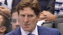 Toronto Maple Leafs head coach Mike Babcock stands behind the bench during a game on Oct. 7, 2015. The Supreme Court of B.C. has tossed out a lawsuit against Mr. Babcock over his investment in a failed hotel project in Squamish, B.C. (Frank Gunn/THE CANADIAN PRESS)