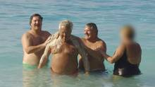 Construction magnate Tony Accurso is shown waist-deep in the ocean scrubbing the back of his cigar-smoking friend, high-powered union boss Jean Lavallée. (Hand Out)