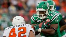 Saskatchewan Roughriders' Wes Cates, right, carries the ball as B.C. Lions' Anton McKenzie moves in for the tackle during the first half of a pre-season CFL football game in Vancouver, B.C., on Wednesday June 22, 2011. (DARRYL DYCK/THE CANADIAN PRESS)